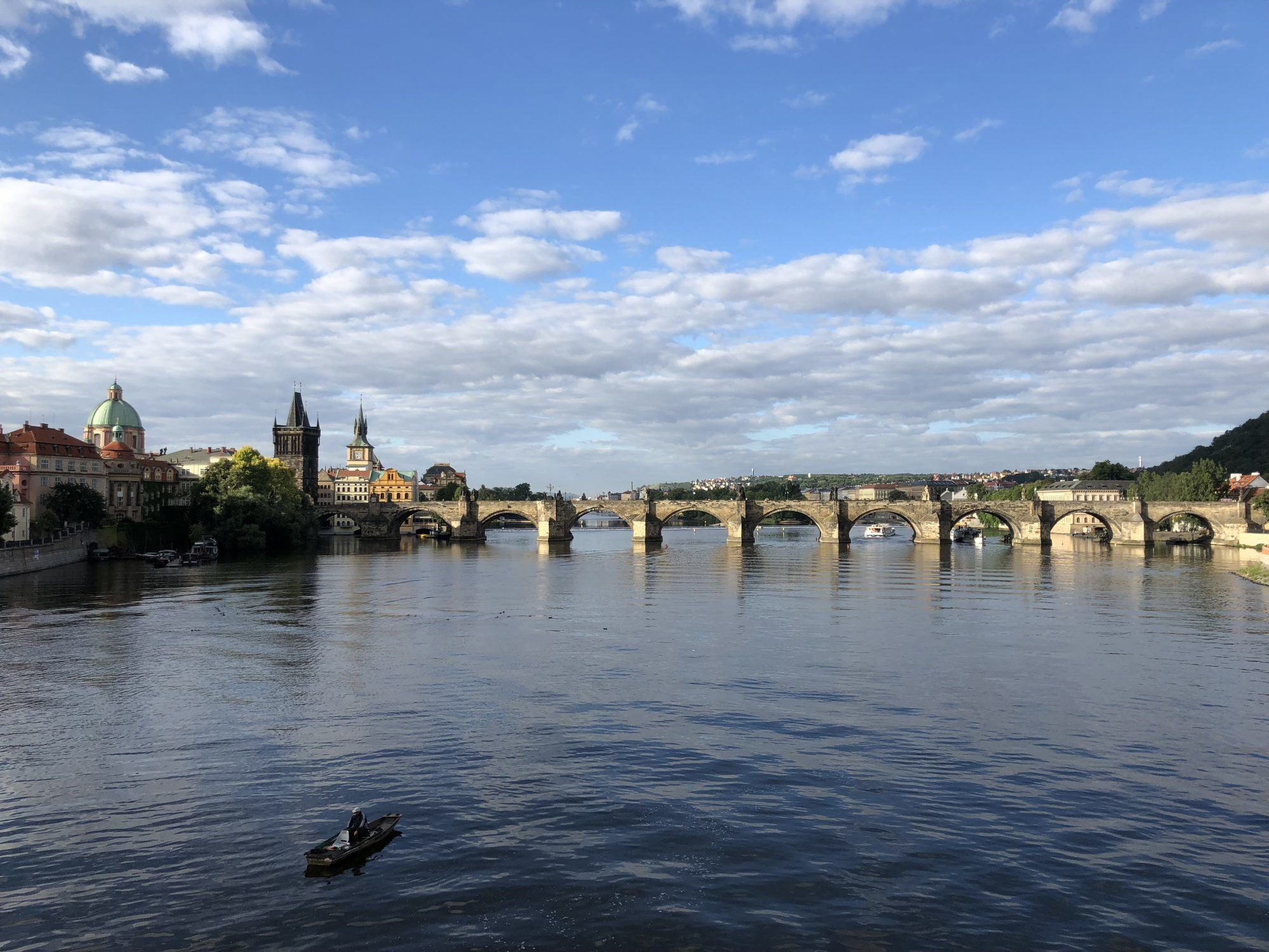 prague charles bridge view from across river early morning empty