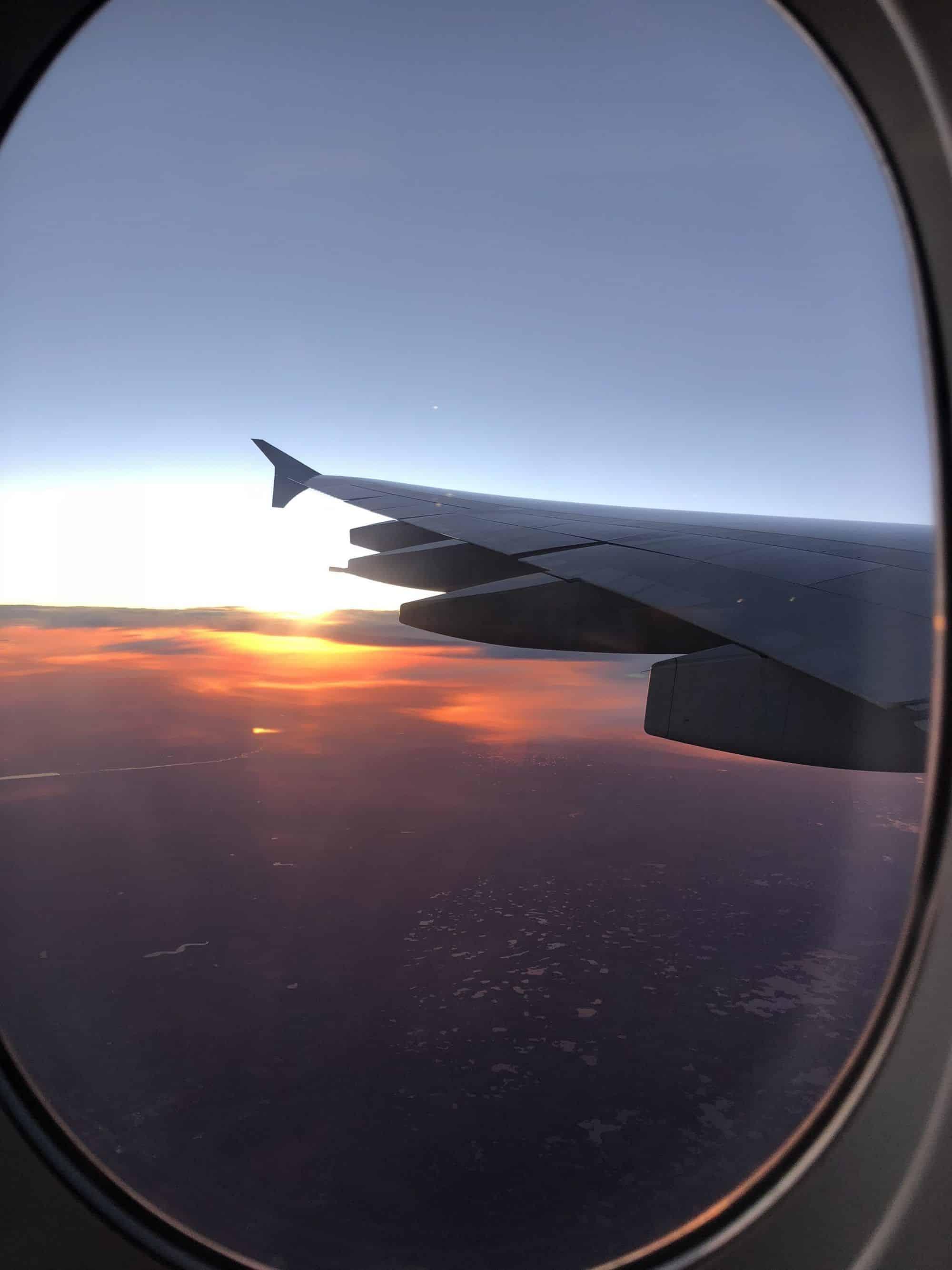 classic travel wing shot at sunset blog blogger